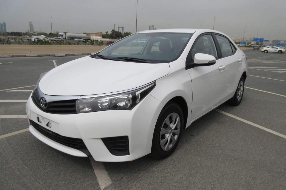 White 2015 Toyota Corolla for sale, 1.6 SE. 100% bank loan can be arranged