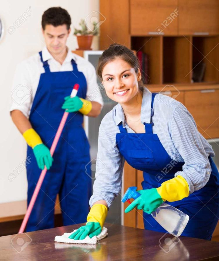 55662617-portrait-of-cleaners-in-overalls-with-supplies-working-in-apartment - Copy.jpg