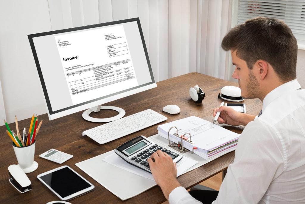 bigstock-Accountant-Calculating-Tax-At-103385042.jpg