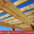 Wood structure framing for a pergola against a blue sky.png