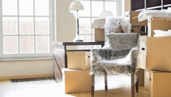 bigstock-Moving-boxes-and-furniture-in-169360670-620x413.jpg