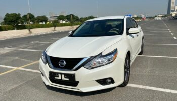 Altima 2017 white MID NEW (1).jpeg