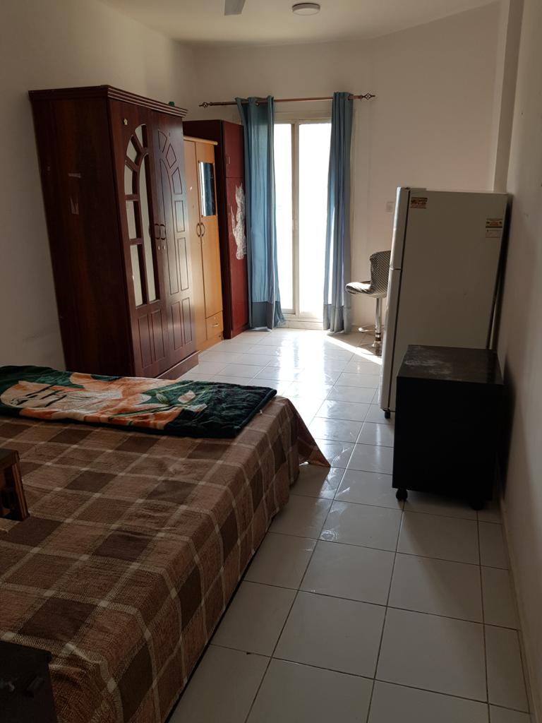 Furnished Master Bedroom With Balcony And Attached Bathroom-Dubai - Image 3