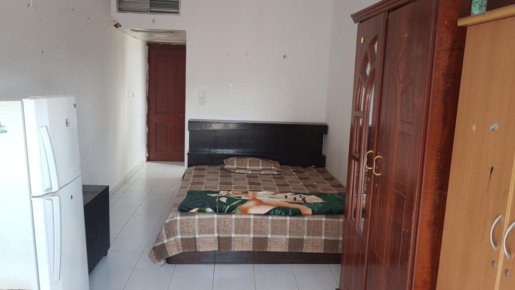 Furnished Master Bedroom With Balcony And Attached Bathroom-Dubai - Image 2