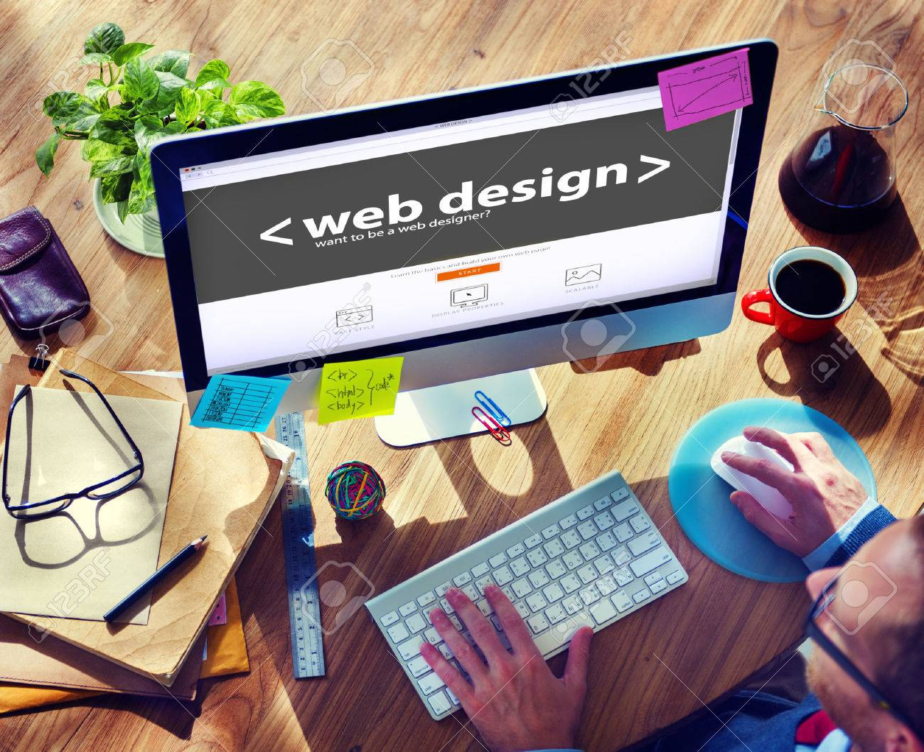 34406843-web-designer-working-on-a-new-project.jpg